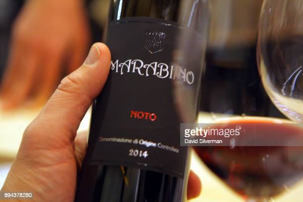 Marabino winery's Noto Nero d'Avola 2014 Sicilian red wine is served during a food and wine pairing dinner at the Rimessa Roscioli restaurant on...