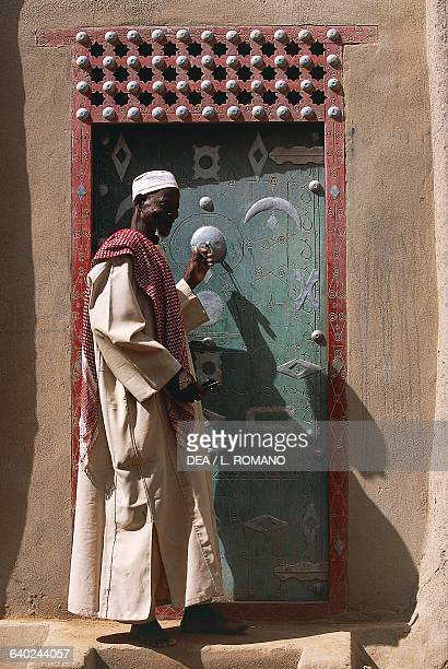 Marabout in front of his house Djenne Mali