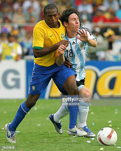 Argentina's footballer Lionel Messi is marked by Brazil's Mineiro during their Copa America Venezuela2007 final match at the Panchencho Romero...