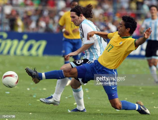 Argentine forward Lionel Messi dribbles the ball past Brazilian midfielder Josue during the final match of Copa America 2007 at the Pachencho Romero...