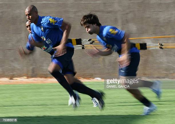 Brazilian defender Alex Silva and forward Diego exercice at the Vereda del Lago sport centre 12 July 2007 Brazil will face Argentina in the final of...