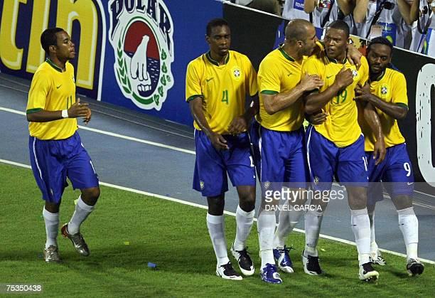 Brazilian forward Robinho defender Juan defender Alex and forward Wagner Love congratulate midfielder Julio Baptista after he scored the second goal...