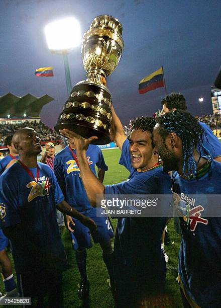 Brazilian midfielder Gilberto Silva defender Elano and forward Vagner Love celebrate with the trophy after Brazil won the Copa America Venezuela2007...