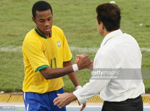 Brazilian player Robinho is congratulated by his coach Dunga during the Copa America Venezuela-2007 final match against Argentina, 15 July, 2007 at...