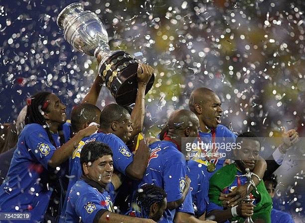 Brazilian players celebrate their victory against Argentina at the end of the 42nd Copa America Venezuela2007 final match at the Pachencho Romero...
