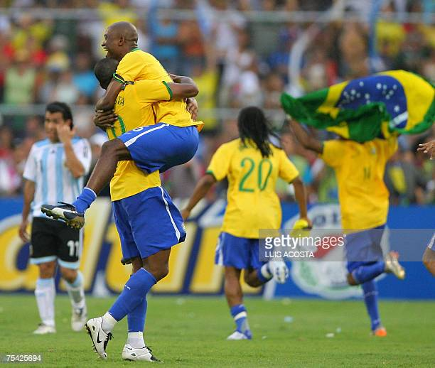 Brazilian players Julio Baptista and Gilberto celebrate at the end of the final match of the Copa America 2007 against Argentina at Pachencho Romero...