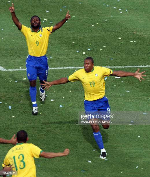 Brazil's footballer Julio Baptista celebrates with teammates his goal against Argentina during their Copa America Venezuela2007 finals match 15 July...