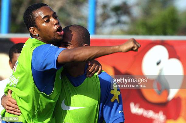 Brazil's footballer Robinho jokes with Afonso during a training session in Maracaibo Venezuela on July 14 2007 Brazil will face Argentina for their...