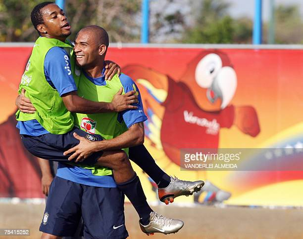 Brazil's footballer Robinho jokes with teammate Afonso during a training session in Maracaibo Venezuela on July 14 2007 Brazil will face Argentina...
