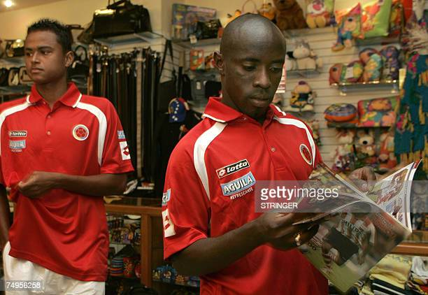 Colombian defender Jair Benitez and midfielder Jaime Castrillon have a look at magazines in the hotel lobby in Maracaibo, Venezuela, June 29th, 2007....
