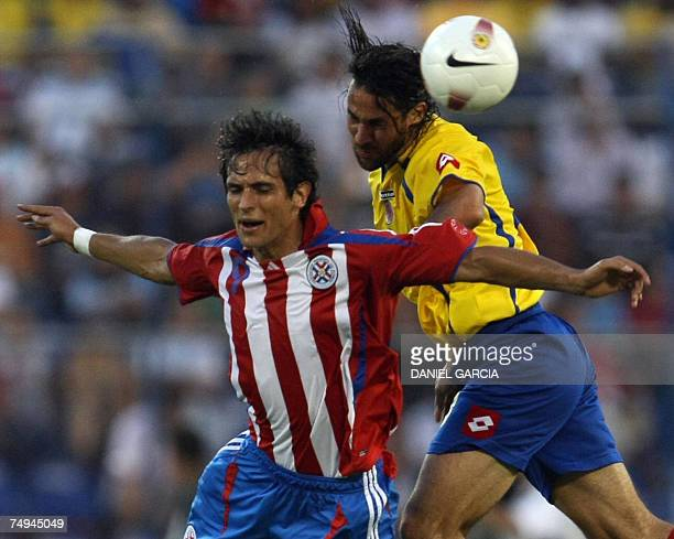 Colombian defender Mario Yepes vies for the ball with Paraguayan forward Roque Santa Cruz during a group C football match of Copa America at...