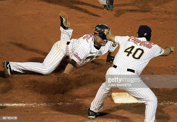Alex Gonzalez of the Lions of Caracas dives back into first base after getting caught in a rundown against the Tigres of Licey in their Caribbean...
