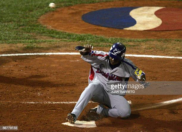 Play Ronnie Belliard of Tigres of Licey of Dominican Republic slides during a game against the Lions Caracas of Venezuela in their Caribbean Series...