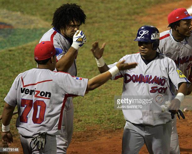Ronnie Belliard of Tigres of Licey of Dominican Republic is congratulated by his teammates after hitting a home run against of Lions Caracas of...