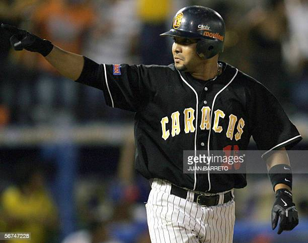 Venezuelan Alex Gonzalez celebrates following his home run against Tigres of Licey of Dominican Republic during a Caribbean Series Baseball game at...