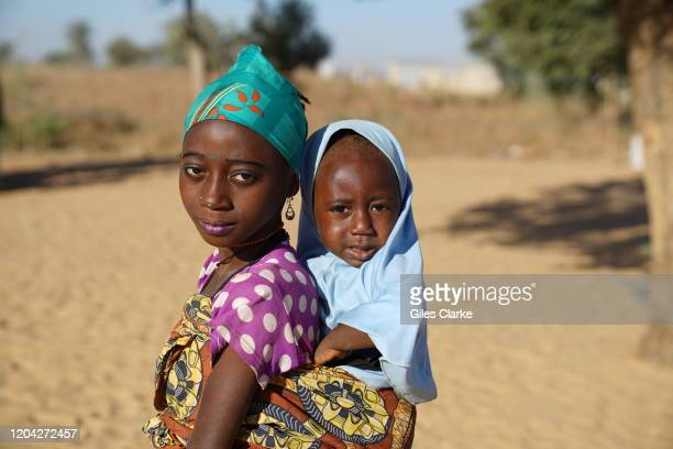 Maradi Refugee Settlement Southern Niger December 12 2019 Two young refugee girls whose families fled violence in northern Nigeria pose for the...