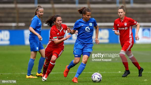 Maral Artin of Bayern challenges Sarah Jabbes of Meppen during the B Junior Girl's German Championship Semi Final match between SV Meppen and Bayern...