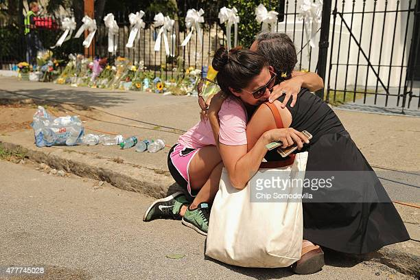 Maranda Mincey of Charleston and Steward Watson of Baltimore weep and embrace outside the historic Emanuel African Methodist Episcopal Church June 19...
