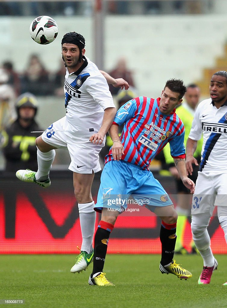 Marano Izco (R) of Calcio Catania competes for the ball with Cristian Chivu of FC Internazionale during the Serie A match between Calcio Catania and FC Internazionale Milano at Stadio Angelo Massimino on March 3, 2013 in Catania, Italy.