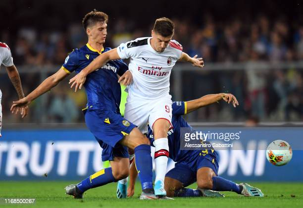 Marash Kumbulla of Hellas Verona competes for the ball with Krzysztof Piatek of AC Milan during the Serie A match between Hellas Verona and AC Milan...