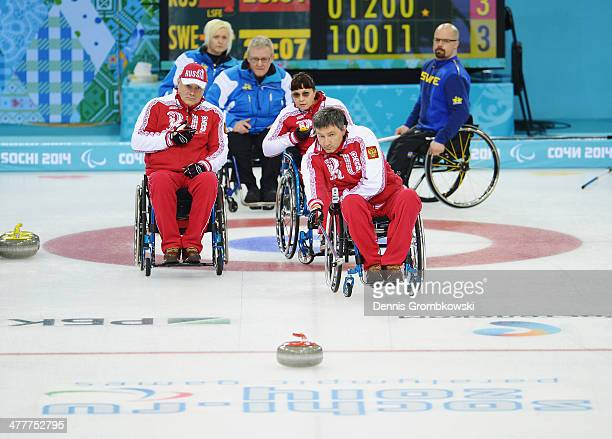 Marat Romanov of Russia competes in the Round Robin Session 7 during day four of Sochi 2014 Paralympic Winter Games at Ice Cube Curling Center on...