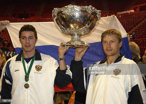 Marat Safin and Yevgeny Kafelnikov of Russia hold the trophy after victory in the fifth rubber during the Davis Cup Final at Paris Bercy Paris on...