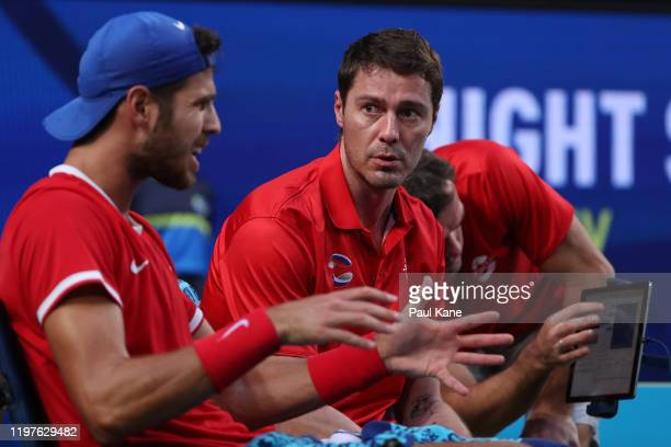 Marat Safin captain of Team Russia talks with Karen Khachanov after winning the second set against Taylor Fritz of Team USA during day three of the...