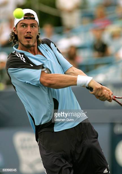 Marat Safin hits a backhand in his match with Jan Hernych during the Western and Southern Financial Group Masters on August 16 2005 at the Lindner...