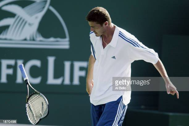 Marat Safin of Russia breaks his racquet after a missed point against Robby Ginepri of the USA during the Pacific Life Open on March 13 2003 at the...