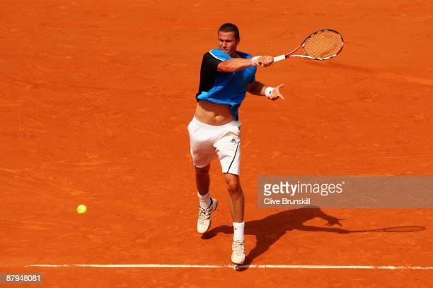 Marat Safin of Russia hits a forehand during his Men's Singles First Round match against Alexandre Sidorenko of France at the French Open on May 24...