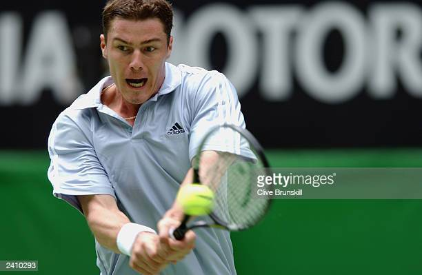 Marat Safin of Russia hits a shot against Raemon Sluiter of The Netherlands during the Australian Open Tennis Championships at Melbourne Park on...