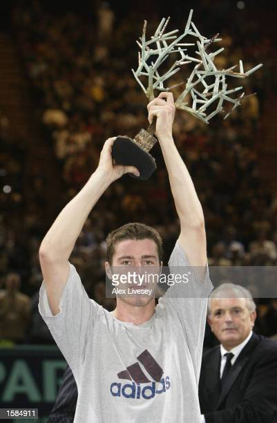 Marat Safin of Russia holds aloft the BNP Paribas Masters trophy after beating Lleyton Hewitt of Australia 76 60 64 in the Final of the BNP Paribas...