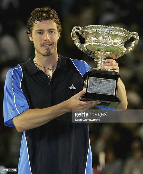 Marat Safin of Russia holds up the trophy after defeating Lleyton Hewitt of Australia during the Men's Final during day fourteen of the Australian...