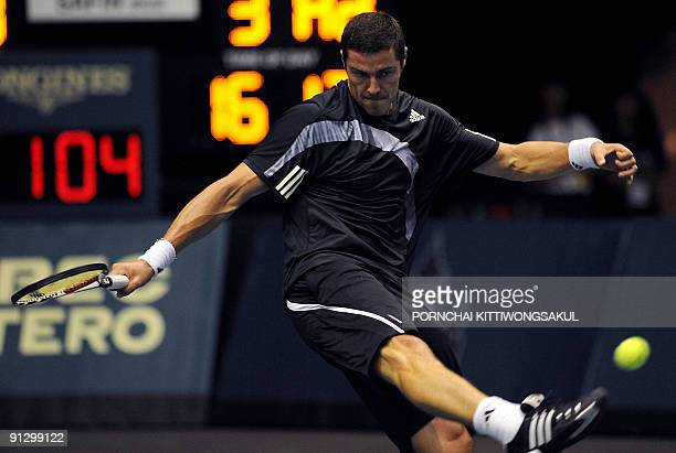 Marat Safin of Russia kicks at a ball during his second round of ATP Thailand Open tennis match against Swiss player Macro Chiudinelli in Bangkok on...