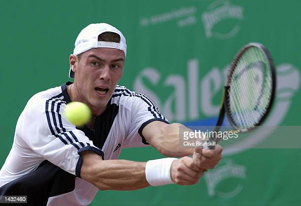 Marat Safin of Russia plays a backhand during his straight sets victory against Lars Burgsmuller of Germany during the first round of the Salem Open...