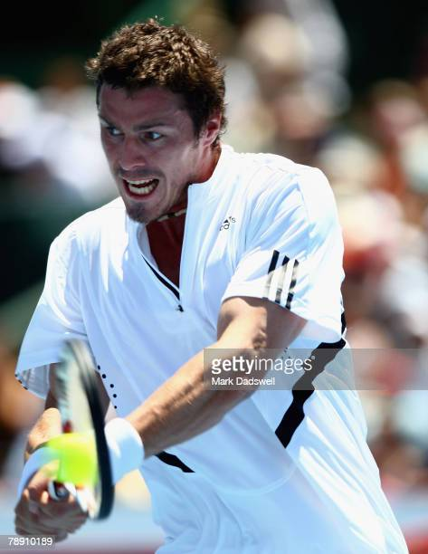 Marat Safin of Russia plays a backhand return in his match with Fernando Conzalez of Chile during day four of the AAMI Classic at Kooyong Lawn Tennis...
