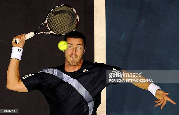 Marat Safin of Russia prepares serves to Swiss player Macro Chiudinelli during their second round of ATP Thailand Open tennis match in Bangkok on...