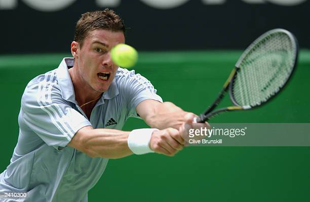 Marat Safin of Russia reaches to make the shot against Raemon Sluiter of The Netherlands during the Australian Open Tennis Championships at Melbourne...