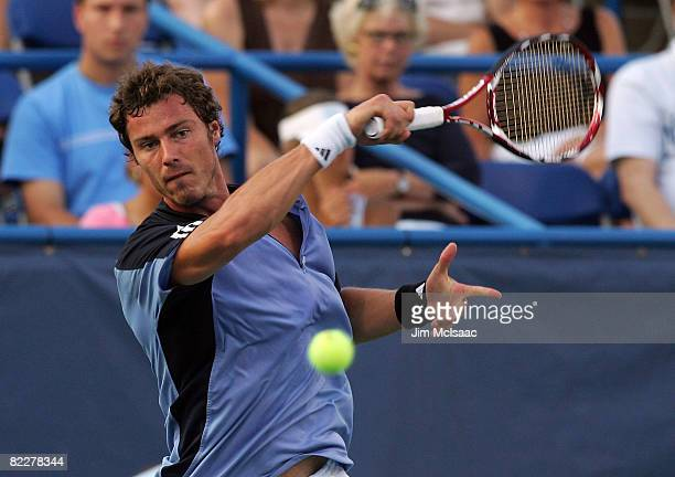 Marat Safin of Russia returns a shot to Fabio Fognini of Italy during the Legg Mason Tennis Classic at the William H.G. FitzGerald Tennis Center on...
