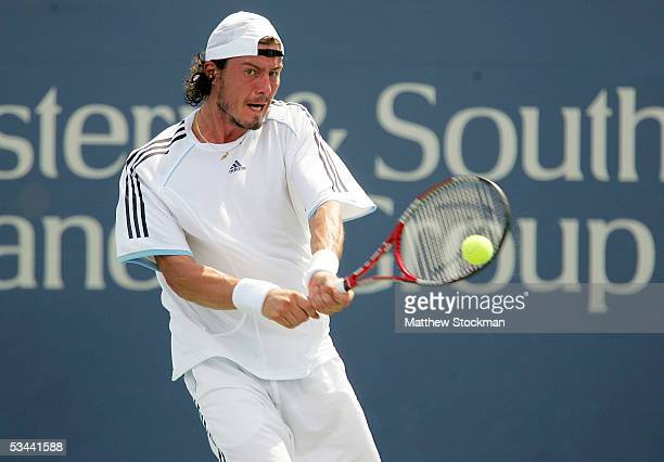Marat Safin of Russia returns a shot to Robbie Ginepri of the USA during the quarterfinals of the Western & Southern Financial Group Masters on...