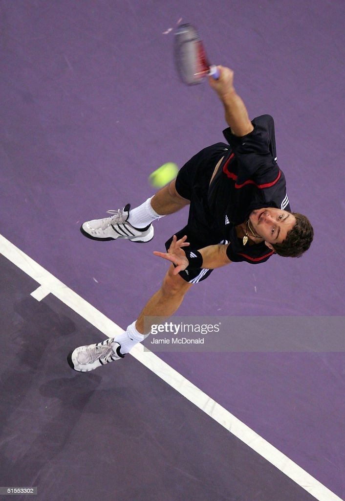 Marat Safin of Russia serves during his semi final match against Andre Agassi of USA during the ATP Madrid Masters at the Nuevo Rockodromo on October 23, 2004 in Madrid, Spain.