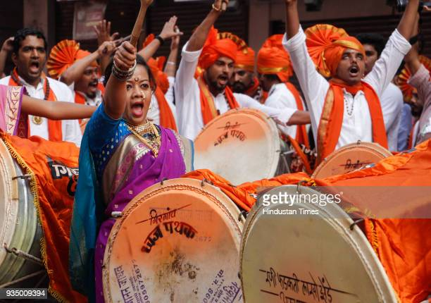 Marathi People playing dhol during Gudi Padwa which is considered as New Year for them at Girgaon on March 18 2018 in Mumbai India
