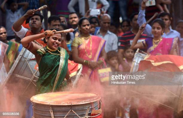 """Marathi woman playing drum during Gudi Padwa celebration which known as Marathi """"New Year"""" at PMGP Colony, Jogeshwari on March 18, 2018 in Mumbai,..."""