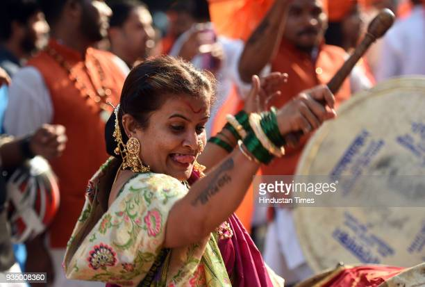 Marathi woman playing drum during Gudi Padwa celebration which known as Marathi New Year at PMGP Colony Jogeshwari on March 18 2018 in Mumbai India