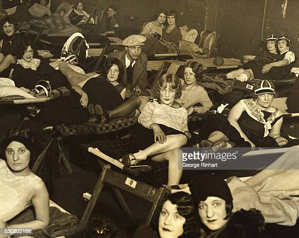 Marathon dancers at the Chicago Coliseum rest on sets during a break after one hour of dancing