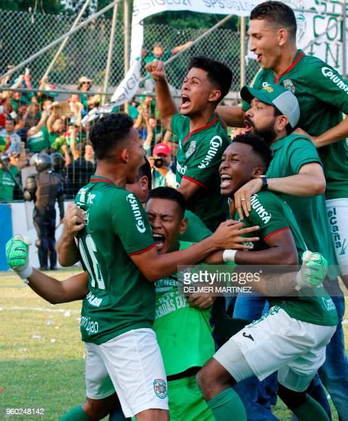 Marathon football players celebrate after defeating Motagua to win the Honduran Clausura Tournament at the Yankel Rosenthal stadium in San Pedro Sula...