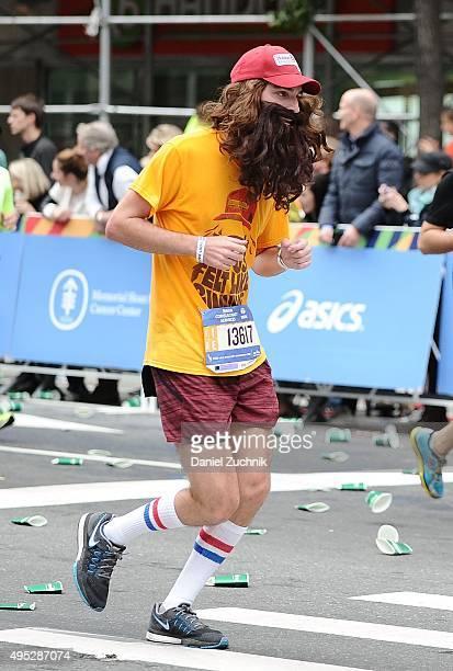A marathon participant runs through the streets of Manhattan during the TCS New York City Marathon on November 1 2015 in New York City