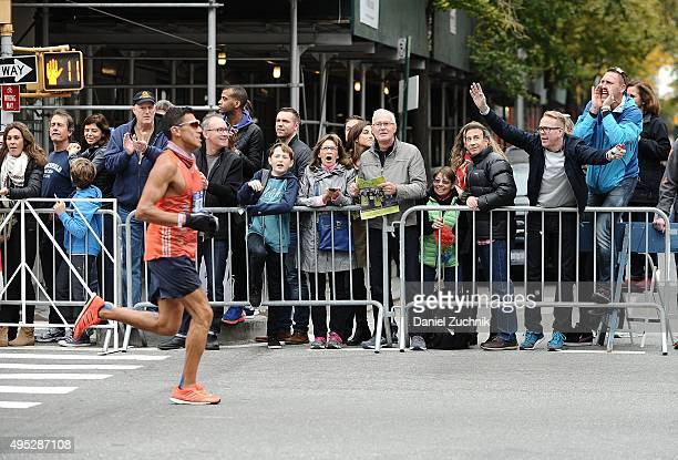 A marathon participant runs through the streets of Manhattan during the TCS New York City Marathon on November 1 2015 in New York City