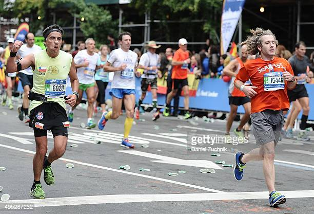Marathon participants run through the streets of Manhattan during the TCS New York City Marathon on November 1 2015 in New York City