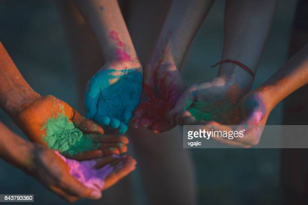 Marathon Racer's Hands With Holi Colors